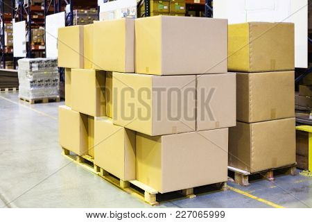 Packaged Boxes And Cartons On Wooden Pallets In Warehouse