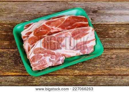 Raw Beef Rib Steak With Bone On Wooden Board And Table Fresh Raw Beef Steak On Wooden Cutting Board