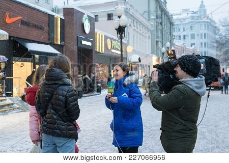 Moscow, Russia - February 11, 2018. Correspondent Of A Tv And Radio Company Mir Takes Interview With