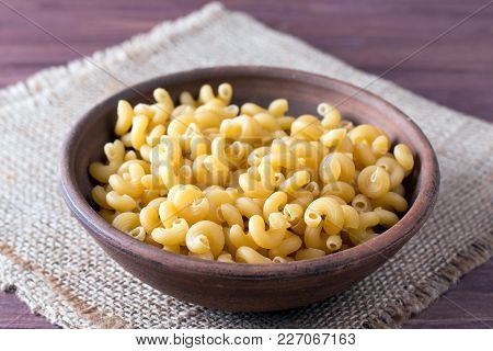 Raw Macaroni In A Bowl On A Table