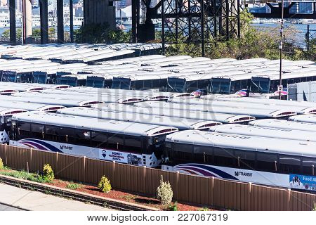 Kearny, USA - October 27, 2017: View of New Jersey with parked buses transit public transportation system, sign