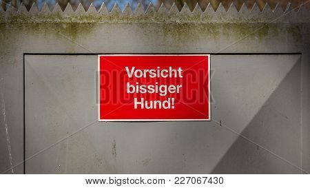 Sign: Attention Vicious Dog (german), On A Steel Door In Oberhausen, Ruhr Area, North Rhine-westphal