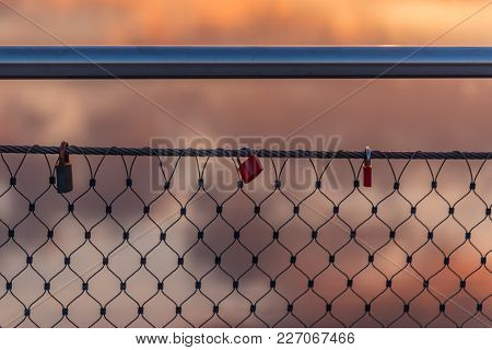 Lovelocks On A Bridge Railing With The Light Of The Setting Sun At The Rhein-herne-canal In Oberhaus