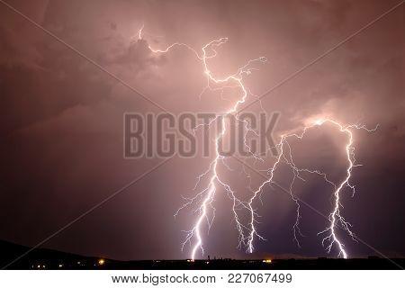 Multiple Lightning Bolts Striking The Gila Bend Mountains Of Arizona.