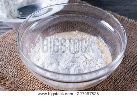Preparing A Dough/batter For Crepes Or Pancakes With Wheat Flour In Glass Bowl, Milk, Eggs