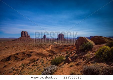 Classic Panoramic View Of Scenic Monument Valley With The Famous Mittens And Merrick Butte Illuminat