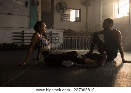 People Relaxing After Exercising At Gym