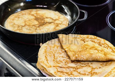 Pancakes For Carnival Are Baked In A Frying Pan, On A Plate