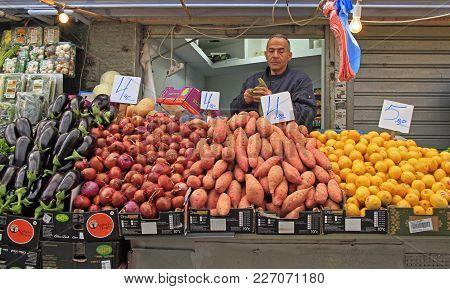 Jerusalem, Israel - December 1, 2017: Man Is Selling Fruits And Vegetables At Machane Yehuda Market