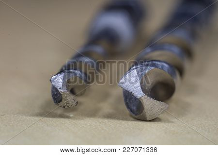 Joinery Accessories In A Large Magnification. The Tip Of The Drill Is Shown In Macro Technology.
