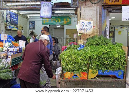 Jerusalem, Israel - December 1, 2017: Man Is Selling Vegetables And At Machane Yehuda Market In Jeru