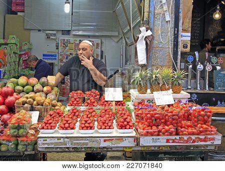 Jerusalem, Israel - December 1, 2017: Man Is Selling At Machane Yehuda Market In Jerusalem, Israel