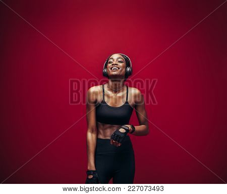 Fitness Woman Relaxing And Listening Music After Her Workout