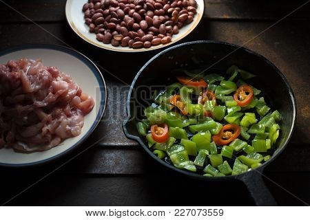 Pieces Of Chicken, Beans. Pepper And Chili In A Frying Pan Horizontal