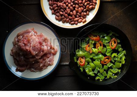 Pieces Of Chicken, Beans. Pepper And Chili In A Frying Pan Top View Horizontal