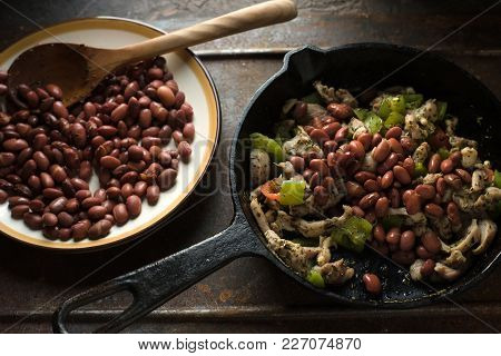 Beans Are Spread In A Frying Pan With Pepper And Chicken Side View Horizontal