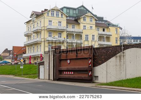 Hotel Cuxhaven With Steel Door In Dike For Water Protection