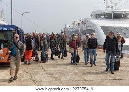 Helgoland, Germany - May 19, 2017: People Just Disembarked The Ferry From Cuxhaven And Walking To Th
