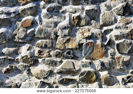 Fragment Of Wall Made Of Rough Uneven Stones
