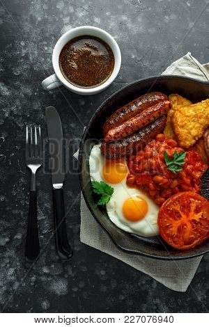 Full English Breakfast With Bacon, Sausage, Fried Egg, Baked Beans, Hash Browns And Mushrooms In Rus