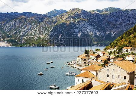 A City With Red Roofs On The Coast