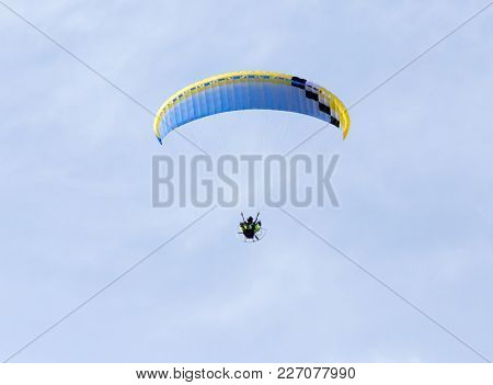 Parachute Flying In The Sky . In The Park In Nature