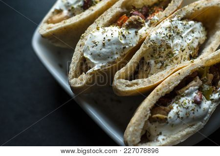 Tortilla Stuffed With Chicken And Vegetables With Sour Cream. Fajita Close-up Horizontal