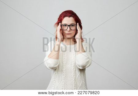 Young Business Woman In Glasses Dressed In White Sweater Frowning Her Face Looking Tired Holding Han
