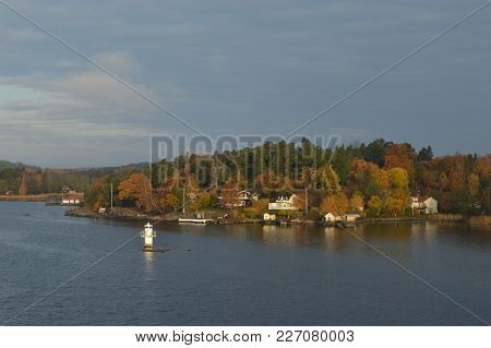 Small Beautiful Islands Of Sweden In Baltic Sea With A Lot Of Colourful Houses, Small Lighthouses, B
