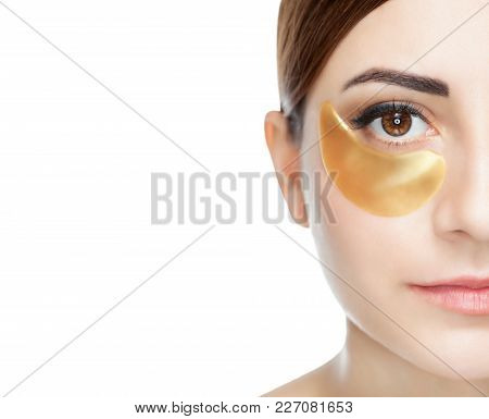 Collagen Gold Patches On The Skin Of The Eyelid, On The Face Of A Beautiful Woman.