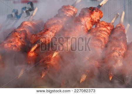 Marinated Meat Shashlik On Preparing On Barbecue Grill. Roast Beef Kebabs Being On The Bbq In Steam