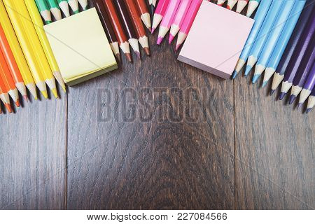 Top View Of Contemporary Wooden Royal Oak Office Workspace With Colorful Supplies And Copy Space. Wo