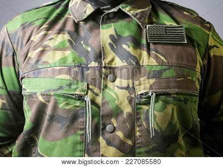 Closeup Photo Of A  Male Chest Standing In Military Jacket.