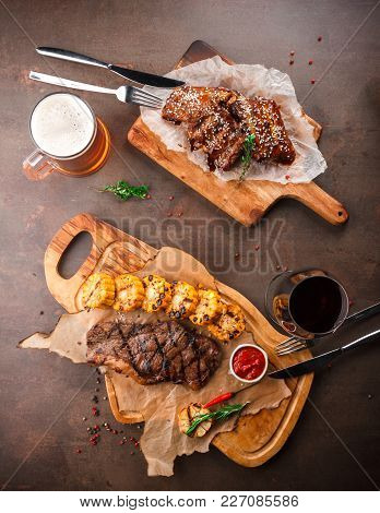 Bbq Spare Ribs With Herbs And Juicy Steak On The Grill With Rosemary, Garlic, Chili And Corn On The