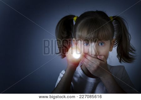 Child Is Afraid Of The Dark. Conceptual Photography.