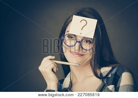 Woman Confused Thinking Seeks A Solution, Paper Card With Question Mark On Her Head. Doubtful Young