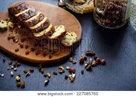 Served Plate With Baked Bread With Raisins And Nuts Cut Into Slices.