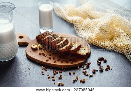 Wooden Board With Served Bread Dessert Stuffed With Raisins And Nuts And Cut Into Slices.