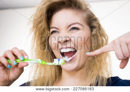 Woman Brushing Cleaning Teeth. Positive Girl With Toothbrush. Oral Hygiene. Studio Shot On White Bac