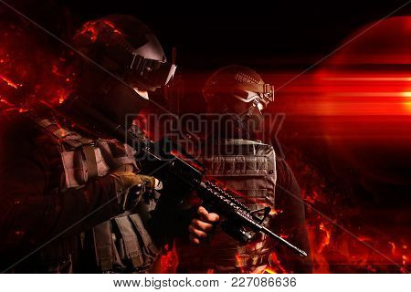 Photo Of A Swat Soldiers Posing With Automatic Rifle In Flame Effects.
