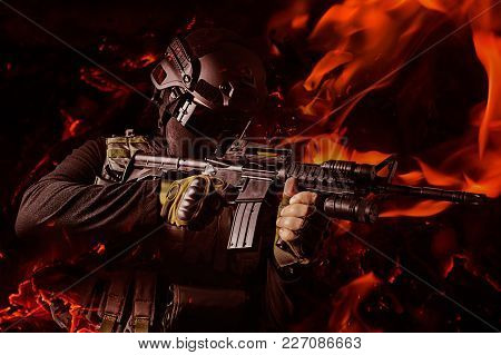 Photo Of A Swat Soldier Aiming Automatic Rifle With Flame Effects.