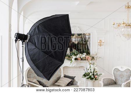 Photographic Studio With Modern Lighting Equipment. Light Spring Room Studio Interior. Luxury Decor
