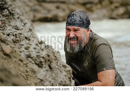 Men Overcame The Watery Mud Barrier During The Legion Legion Run Race Held In Kiev