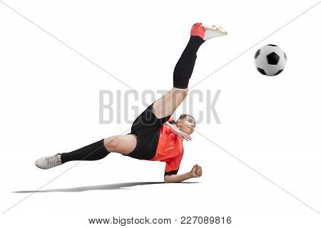 Female Football Player In Orange Uniform Making Bicycle Kick Isolated On White