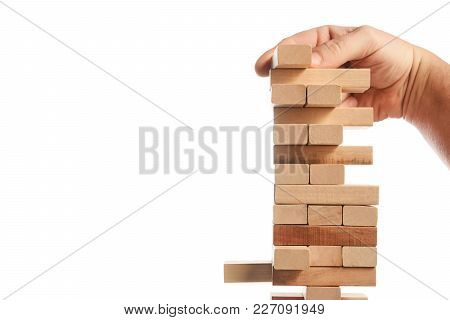 Wood Block Tower Game On White Background. Planning, Risk And Strategy Of Project Management In Busi