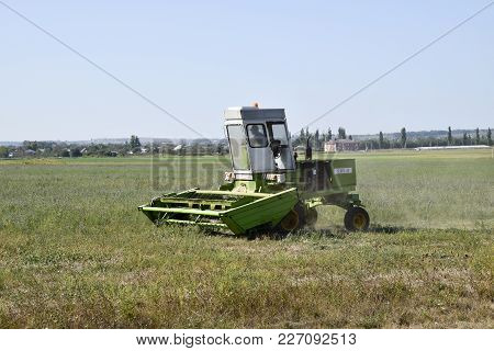Novorossiysk, Russia - September 06, 2016: Mower In The Field Mows The Grass For Hay.