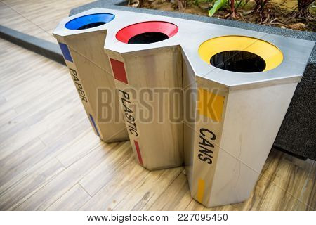 Three Color Trashs Separates Each Type Of Garbage.