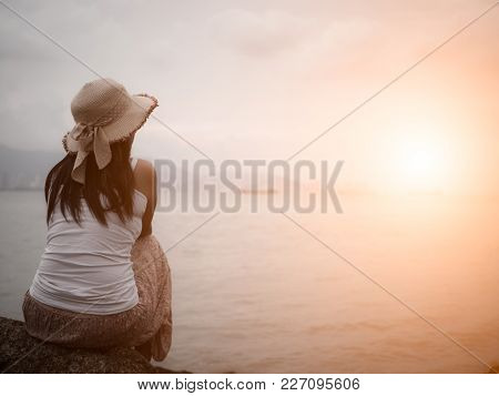 Retro Style Of Lonely And Depressed Woman Sitting In Front Of The Sea In A Deserted Beach. Broken He