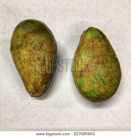 Two empty avocado half