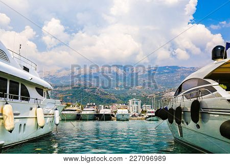 Luxury Yachts And Sailing Ships Moored At Wharf In Budva Marina, Montenegro. Port In Mediterranean S